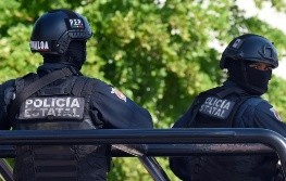 Policemen stand guard in the area where heavily armed gunmen waged an all-out battle against Mexican security forces in Culiacan, Sinaloa state, Mexico, on October 18, 2019. - Mexico